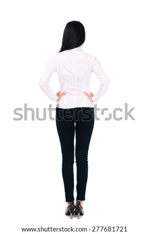 Back view portrait of a businesswoman standing isolated on a white background - stock photo
