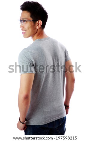 Back view portrait of a young happy asian man over white background - stock photo