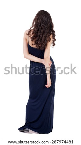 back view standing young beautiful  woman.  girl  watching. Rear view people collection. backside view of person.  Isolated over white background. Girl in blue evening dress is hand clasping his hand - stock photo