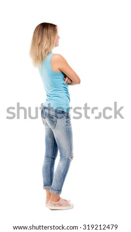 back view standing young beautiful woman. girl watching. Rear view people collection.  backside view of person.  Isolated over white background - stock photo