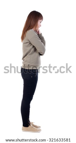 back view standing young beautiful woman. girl watching. Rear view people collection.  backside view person. Isolated over white background. Girl standing sideways, wondering resting his fist on cheek - stock photo