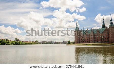 Back view to the lake around Frederiksborg Slot, Hillerod, near Copenhagen, Denmark - stock photo