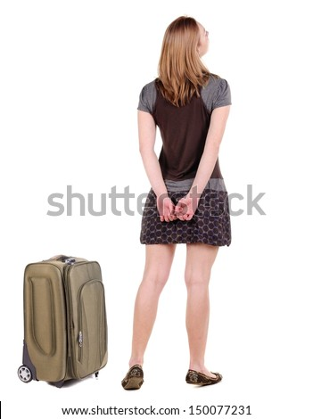 Back view traveling blonde woman with suitcase looking up. Rear view people collection. backside view person. Isolated over white background. resting his hand on hip girl thoughtfully looks forward - stock photo