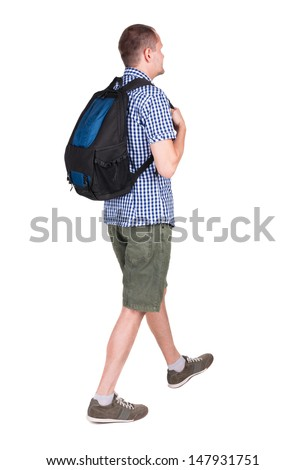 back view walking man with backpack.  brunette guy in motion. backside view person.  Rear view people collection. Isolated over white background. young man goes to side of rolling travel bag on wheels