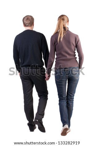 Back view walking young couple. going friendly girl and guy together. Rear view people collection. backside view person. Isolated over white. thoughtful couple of office workers hold hands inches up - stock photo