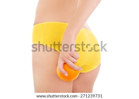 Back view woman in underwear holding an orange. - stock photo