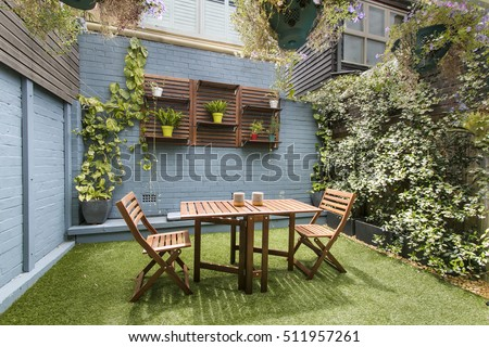 back yard with outdoor seating and barbecue with family. beautiful house
