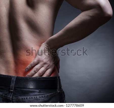 Backache. Pain in the lower back. Man's back - stock photo