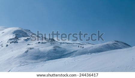 Backcountry skiers on a clear blue day.