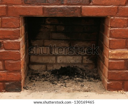 Backdrop of a brick fireplace wall in a vacant setting - stock photo