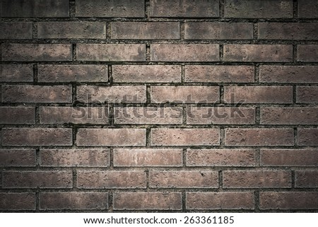 Backdrop of an old and weathered brick wall. This horizontal empty surface is perfect as copy space or textured background.  - stock photo