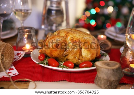 Backed chicken on a Christmas table setting