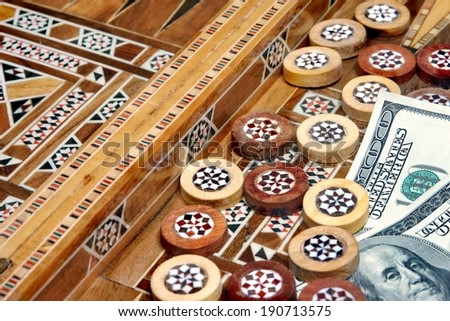 Backgammon Board and two hundred dollar as the prize or bet - stock photo