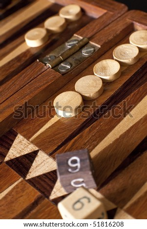 Backgammon board in wood with dices on it. - stock photo