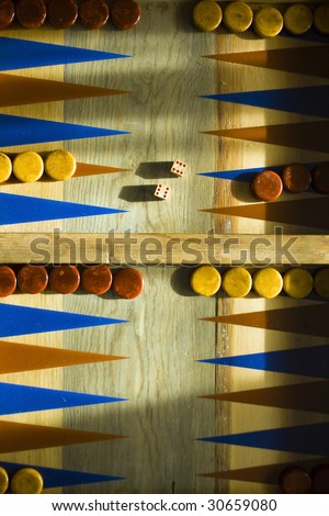 Backgammon Board with a pair of six's thrown on the dice. - stock photo