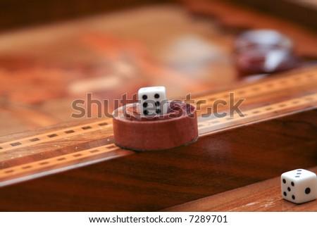 backgammon game in progress - stock photo