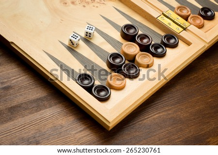 Backgammon set with dice on wooden background  - stock photo