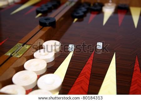 Backgammon table and dice - stock photo