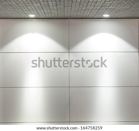 Backgroun of Empty white wall with 2 spot lights and gray stones brick floor - stock photo