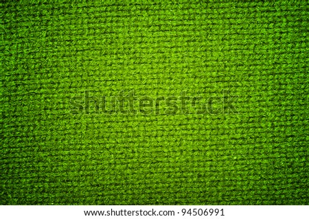 Background a texture a knitted woolen fabric of dark green color - stock photo