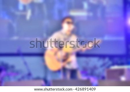 Background abstract blurred of Singer playing guitar on stage