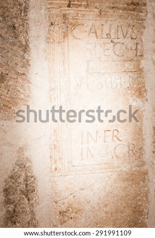 Background Ancient stone vignette background, European with Roman lettering - stock photo