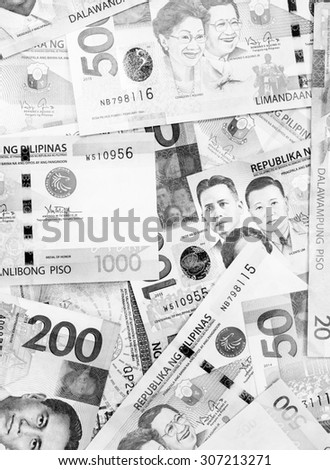 Background and texture of Philippines currency banknotes on black and white color - stock photo