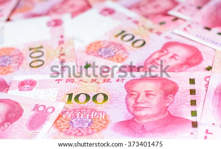 Background and texture with new series of 100 chinese yuan currency,money.Focus on eyes Mao Tse Tung of banknotes