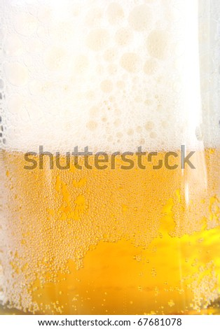 Background beer with magnificent foam. Alcohol.