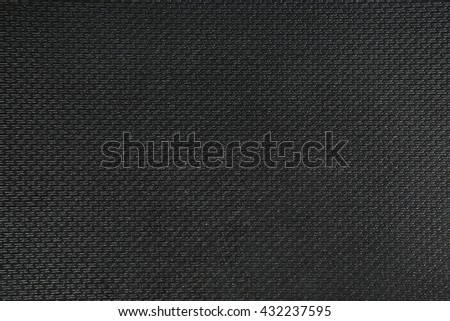 background black rough textural fabric - stock photo