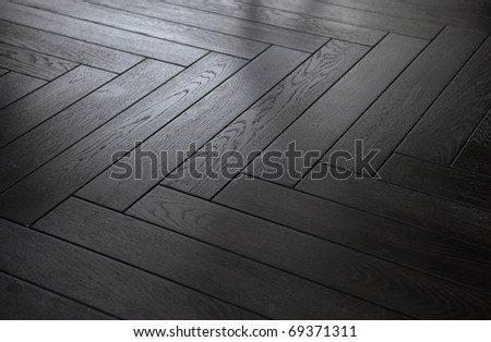 background black wooden parquet floor herringbone pattern - stock photo