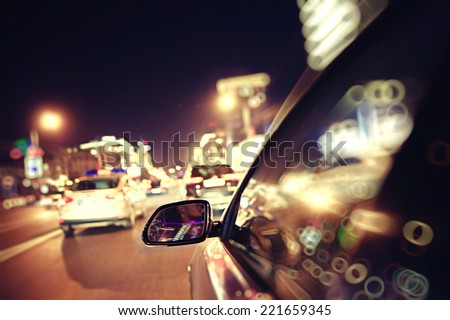 background blur night traffic jams traffic speed - stock photo