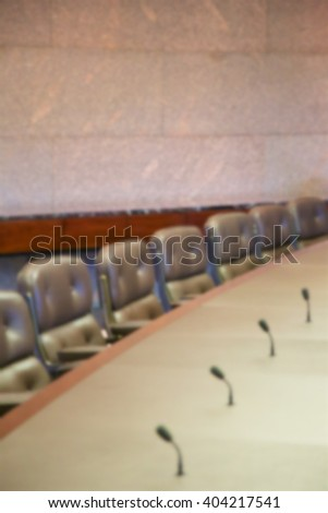 Background blur of empty seats at a board room table. - stock photo