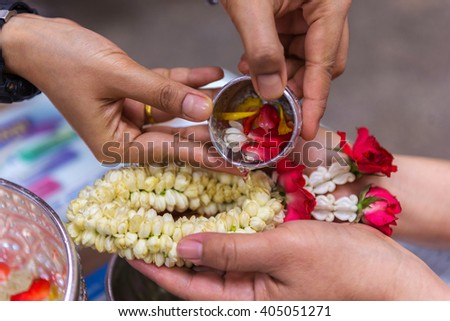 Background blurred Baptist pouring water Buddhist rituals are public. And made popular during Songkran.Songkran is Thailand's New Year celebration. - stock photo