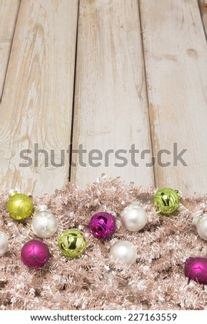 background - bright wood with christmas balls and tree garland - salmon  - stock photo