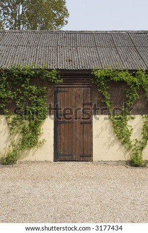 background close up image, barn door to a shed taken in a farmers yard may well have been stable blocks at one time