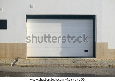 Background closed garage gate in modern building - stock photo