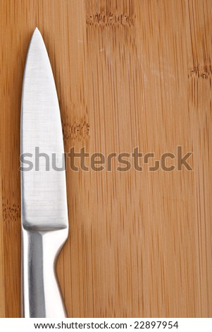 background closeup breadboard and knife