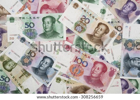 Background collage of Chinese Rmb bank notes  or Yuan with Chairman Mao on the front of each bill - stock photo