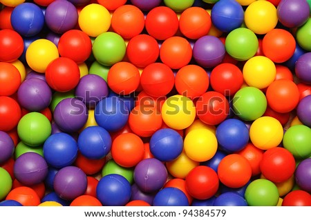 Background, colorful plastic balls on children's playground - stock photo