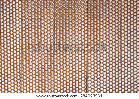 Background composed with perforated metal sheet and in an advanced oxidation state - stock photo
