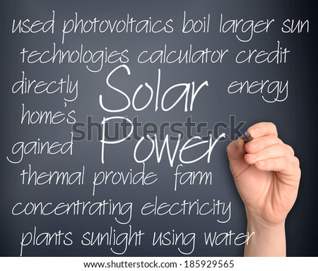 Background concept illustration of solar power energy handwritten on dark background - stock photo
