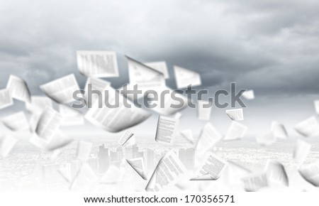 Background conceptual image with papers flying in air - stock photo