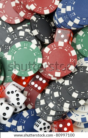 background  consists of casino chips and dice  game