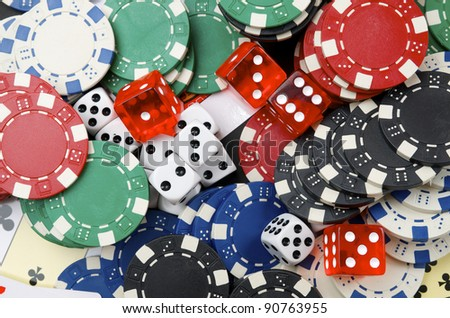 background  consists of casino chips and dice  game - stock photo