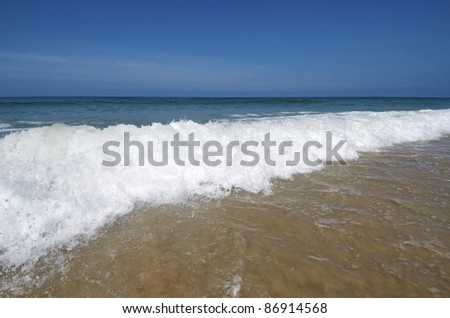 background created by a wave at sea on a clear day - stock photo