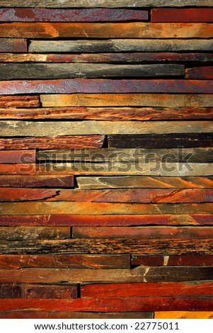 Background detail of aged and colorful stone wall - stock photo