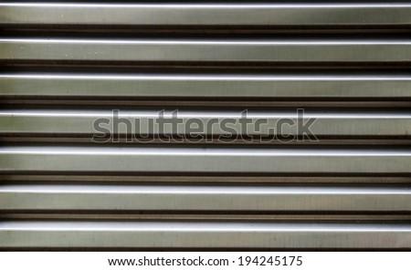 Background Detail of texture aluminium door Corrugated Iron Panelling - stock photo
