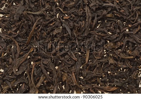Background filled with dry chineese tea leafs - stock photo