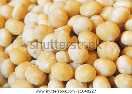 Background filled with salted macadamia nuts - stock photo